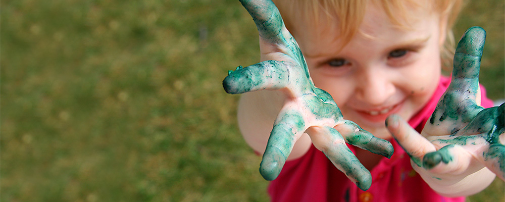 preschool boy with paint on his hands