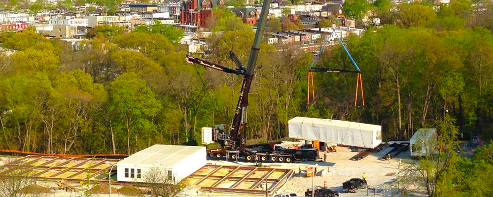crane moving one of the boxes